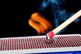 Matchstick on fire — Stock Photo