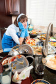 Woman washing dishes — Stock Photo