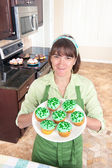 Woman making cupcakes — Stock Photo