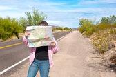 Woman reading roadmap — Stock Photo
