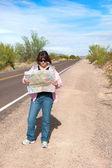 Woman reading map — Stock Photo