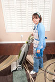 Woman vacuuming floor — Stock Photo