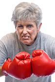 Grandmother and boxing gloves — Stock Photo