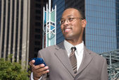 Businessman and cell phone — Stock Photo