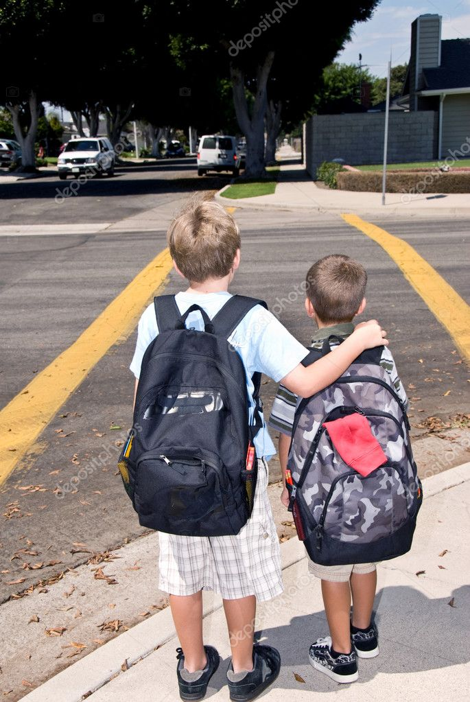 Two brothers wait at a crosswalk for oncoming traffic — Stock Photo #7452553
