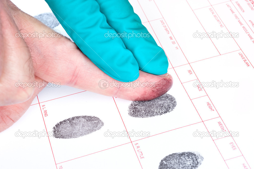A man is being finger printed for either a crime of for FBI screening on a legal document form. — Stock Photo #7454192