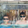 Boys in a swimming pool — Stock Photo