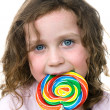 Little girl and pin wheel candy sucker — Stock Photo #7636855