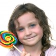 Little girl and candy pin wheel sucker — Stock Photo #7636858