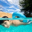 Boy swimming in pool with float ring — Stock Photo