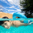 Boy swimming in pool with float ring - Lizenzfreies Foto