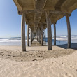 Pier on beach — Stock Photo