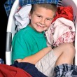 Boy in clothes basket — Stock Photo