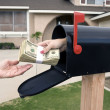 Mailbox handing over money - Stock Photo