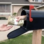 Mailbox handing over money — Stock Photo #7637071