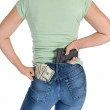 Woman with gun and cash — Stock Photo