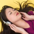 Woman listening to music — Stock Photo #7637238
