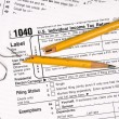 Tax forms and frustration - Stock Photo