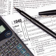 Stock Photo: Tax forms, calculator and pen