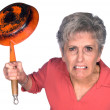 Angry woman with frying pan — Stock fotografie