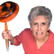 Angry woman with frying pan - Stock Photo