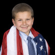 Boy with American flag around shoulders — Stock Photo #7637491