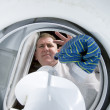 Stock Photo: Mdoing laundry