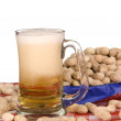 Mug of beer with peanuts — Stock Photo