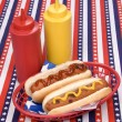 Stock Photo: Fourth of July hotgogs with ketchup and mustard