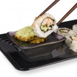 Sushi roll and chopsticks - Stock Photo
