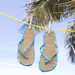 Flip flops hanging on clothesline — Stock Photo