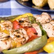 Barbecued chicken kebab dinner — Stock Photo #7637694