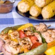 Barbecued chicken kebab dinner — Stock Photo