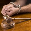 Arrested man and gavel - Stock Photo