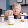 Pharmacist and medications — Stock Photo