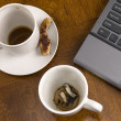 Stock Photo: Coffee mugs and stress with laptop