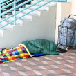 Homeless person sleeping - Stock Photo