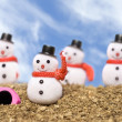 Snowmen on the beach — Stock Photo