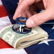 American flag and cash with stethoscope - Stock Photo