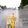 Flooded street sign - Stock Photo