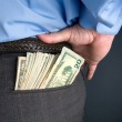 Businessman with cash in back pocket — Stock Photo #7638182