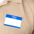 Businessman with a blank nametag — Stock Photo