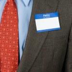 Businessman wearing blank nametag — Stock Photo