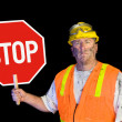 Construction worker holding stop sign — Photo