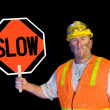 Dirty construction worker holding slow sign — Photo