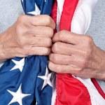 Elderly woman holding American flag — Stock Photo #7638376