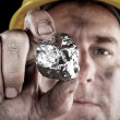 Silver miner with nugget - Stock Photo