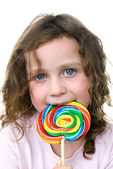 Little girl and pin wheel candy sucker — Stock Photo