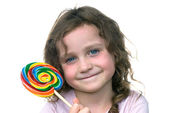 Little girl and candy pin wheel sucker — Stock Photo