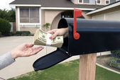 Mailbox handing over money — Stock Photo